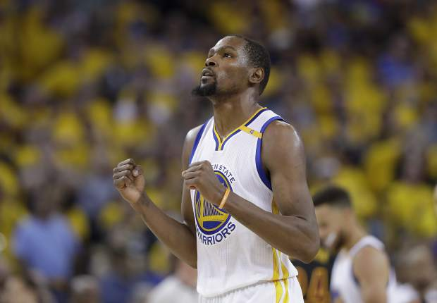 Golden State Warriors forward Kevin Durant reacts after scoring against the Cleveland Cavaliers during Game 5 of basketball's NBA Finals in Oakland, Calif., Monday. Durant was named the NBA Finals MVP.