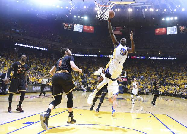 Golden State Warriors forward Draymond Green (23) shoots against the Cleveland Cavaliers during the first half of Game 5 of basketball's NBA Finals in Oakland, Calif., Monday, June 12, 2017. (Kyle Terada/Pool Photo via AP)