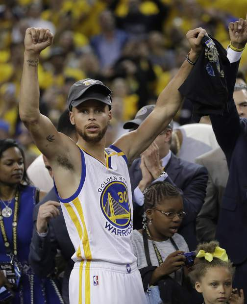 Golden State Warriors guard Stephen Curry celebrates after Game 5 of basketball's NBA Finals against the Cleveland Cavaliers in Oakland, Calif., Monday, June 12, 2017. The Warriors won 129-120 to win the NBA championship. (AP Photo/Marcio Jose Sanchez)