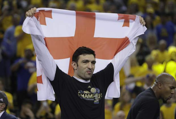 Golden State Warriors center Zaza Pachulia celebrates after Game 5 of basketball's NBA Finals against the Cleveland Cavaliers in Oakland, Calif., Monday, June 12, 2017. The Warriors won 129-120 to win the NBA championship. (AP Photo/Marcio Jose Sanchez)