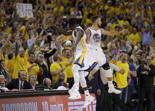 Golden State Warriors forward Draymond Green, left, and guard Stephen Curry (30) celebrate during the second half of Game 5 of basketball's NBA Finals against the Cleveland Cavaliers in Oakland, Calif., Monday, June 12, 2017. The Warriors won 129-120 to win the NBA championship. (AP Photo/Marcio Jose Sanchez)