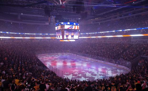 Fans sing the national anthem at PPG Paints Arena on Sunday, June 11, 2017, in Pittsburgh as they watch television coverage of Game 6 of the NHL hockey Stanley Cup final taking place in Nashville, Tenn., between the Pittsburgh Penguins and the Nashville Predators. (Antonella Crescimbeni/Pittsburgh Post-Gazette via AP)