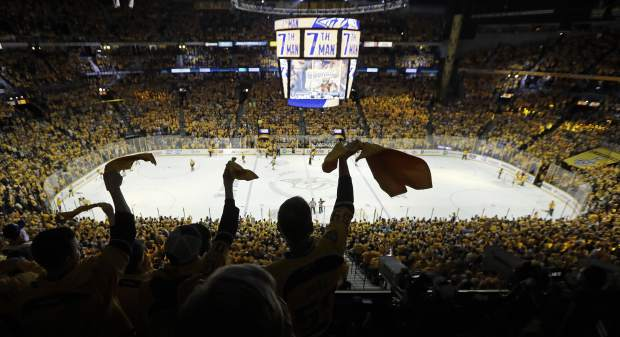 Nashville Predators fans cheer in the final moments of the third period in Game 4 of the NHL hockey Stanley Cup Finals against the Pittsburgh Penguins Monday, June 5, 2017, in Nashville, Tenn. The Predators won 4-1 to tie the series 2-2. (AP Photo/Mark Humphrey)