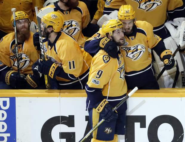 Nashville Predators left wing Filip Forsberg (9), of Sweden, is congratulated by Frederick Gaudreau (32) after Forsberg scored an empty net goal against the Pittsburgh Penguins during the third period in Game 4 of the NHL hockey Stanley Cup Finals Monday, June 5, 2017, in Nashville, Tenn. The Predators won 4-1 to tie the series 2-2. (AP Photo/Mark Humphrey)