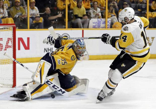 Nashville Predators goalie Pekka Rinne (35), of Finland, stops a shot by Pittsburgh Penguins left wing Chris Kunitz (14) during the second period in Game 4 of the NHL hockey Stanley Cup Finals Monday, June 5, 2017, in Nashville, Tenn. (AP Photo/Mark Humphrey)
