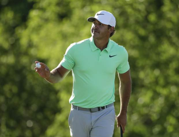 Brooks Koepka reacts after his birdie on the 15th hole during the fourth round of the U.S. Open golf tournament Sunday, June 18, 2017, at Erin Hills in Erin, Wis. (AP Photo/Charlie Riedel)