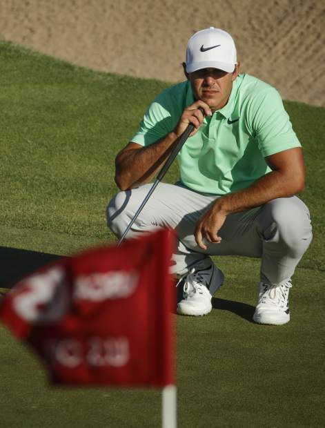 Brooks Koepka lines up a putt on the 16th hole during the fourth round of the U.S. Open golf tournament Sunday, June 18, 2017, at Erin Hills in Erin, Wis. (AP Photo/Charlie Riedel)