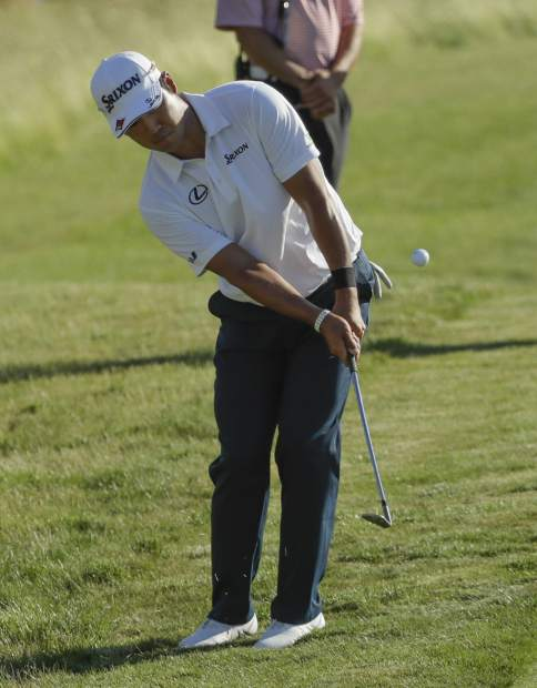 Hideki Matsuyama, of Japan, chips to the 18th green during the fourth round of the U.S. Open golf tournament Sunday, June 18, 2017, at Erin Hills in Erin, Wis. (AP Photo/David J. Phillip)