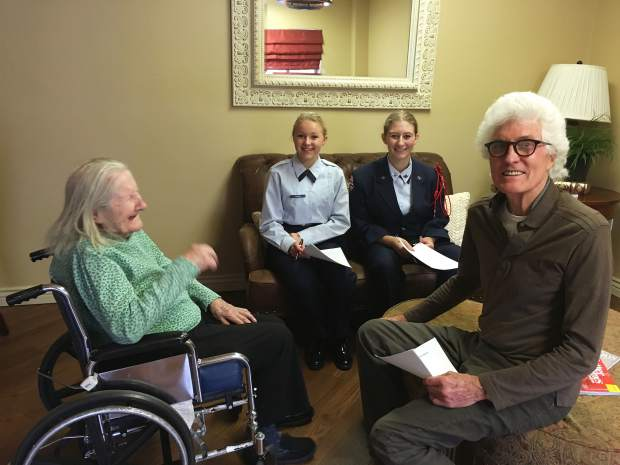 One of the Grace Health Care residents, named Sheila, with two of the GSHS Jr. ROTC cadets, including Sophie Pittenger, on couch at right, and visitor Bill Stirling, who says they had just been singing some Irish ditties.