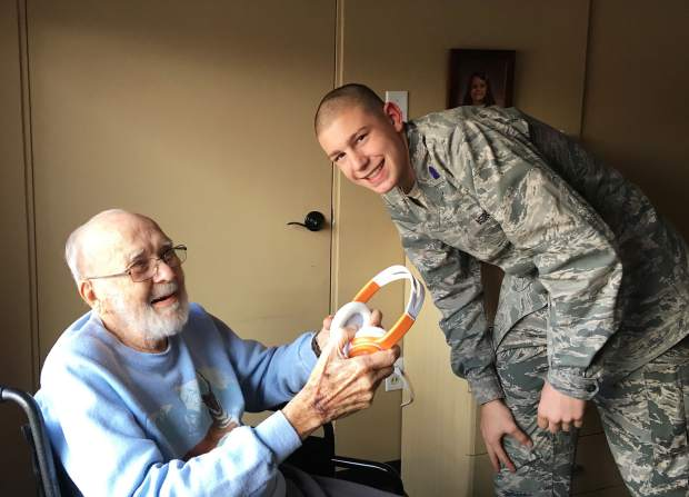 Glenwood Springs High School Air Force Jr. ROTC cadet Austin Hawkins with Dave Hostetler, the Grace Health Care resident he worked with to provide musical memories through Igniting the Spark – Alive Inside.