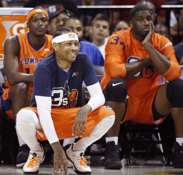 3's Company player/captain and coach Allen Iverson, center, kneels on the sideline during the first half of Game 3 in the BIG3 Basketball League debut, Sunday, June 25, 2017, at the Barclays Center in New York. (AP Photo/Kathy Willens)