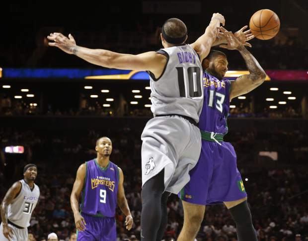 Ghost Ballers player/captain Mike Bibby (10) knocks the ball from 3 Header Monsters' Eddie Basden (13) during the first half of Game 1 in the BIG3 Basketball League debut, Sunday, June 25, 2017, at the Barclays Center in New York. (AP Photo/Kathy Willens)