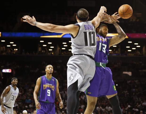 Ghost Ballers player/captain Mike Bibby, (10), left, knocks the ball from 3 Header Monsters Eddie Basden (13) during the first half of Game 1 in the BIG3 Basketball League debut, Sunday, June 25, 2017, at the Barclays Center in New York. (AP Photo/Kathy Willens)