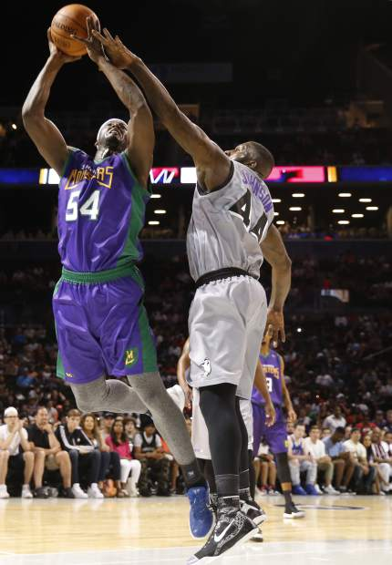 Ghost Ballers Ivan Johnson, (44) tries to strip the ball from 3 Headed Monsters' Kwame Brown (54) during the first half of the first game in the BIG3 Basketball League debut, Sunday, June 25, 2017, at the Barclays Center in New York. (AP Photo/Kathy Willens)