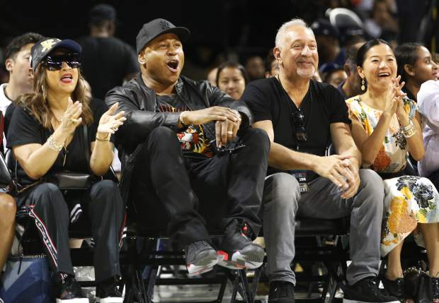 Rapper LL Cool J, second from left, reacts as he watches during the first half of Game 1 in the BIG3 Basketball League debut, Sunday, June 25, 2017, at the Barclays Center in New York. (AP Photo/Kathy Willens)