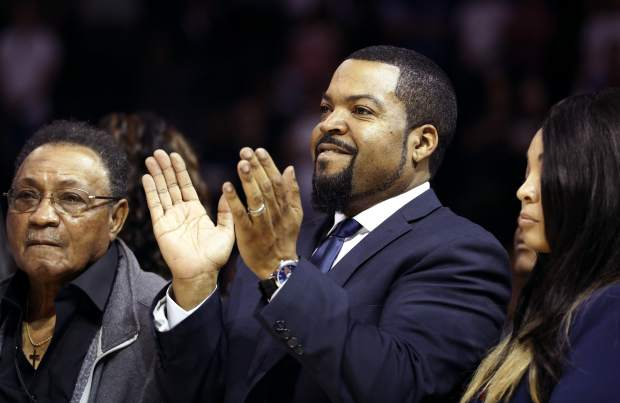 BIG3 Basketball League founder Ice Cube, center, applauds during Game 1 of the league's debut, Sunday, June 25, 2017, at the Barclays Center in New York. (AP Photo/Kathy Willens)