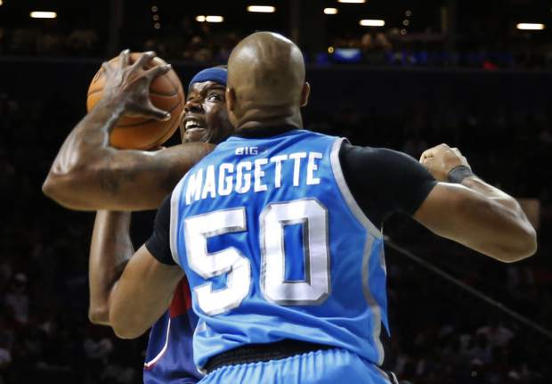 Tri State player-captain Jermaine O'Neal, left, looks to shoot with Power player/captain Corey Maggette (50) defending during the first half of Game 2 in the BIG3 Basketball League debut, Sunday, June 25, 2017, at the Barclays Center in New York. (AP Photo/Kathy Willens)