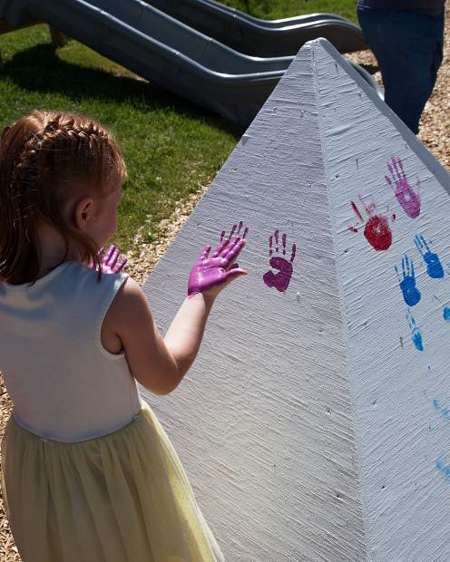 Local kids had plenty of opportunities to make their mark on the playground during the grand opening on Saturday.