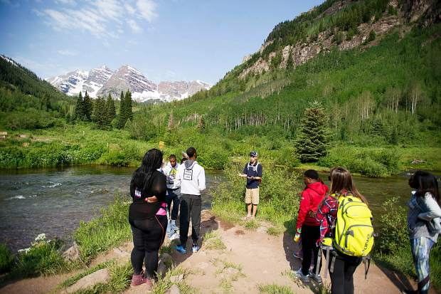 A naturalist leads a tour of the Maroon Bells Scenic Area Wednesday for a group attending the Aspen Ideas Festival.