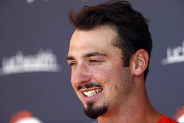 Denver Broncos quarterback Paxton Lynch jokes with reporters after the team's NFL football mandatory minicamp session Tuesday, June 13, 2017, at the team's headquarters in Englewood, Colo. (AP Photo/David Zalubowski)