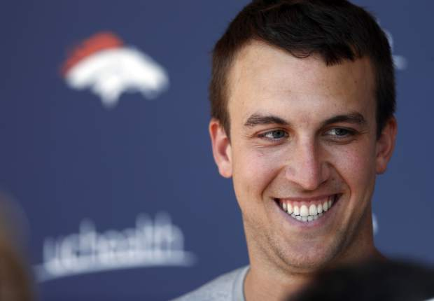 Denver Broncos quarterback Trevor Siemian jokes with reporters after the team's NFL football practice, Tuesday, June 13, 2017, at the team's headquarters in Englewood, Colo. (AP Photo/David Zalubowski)