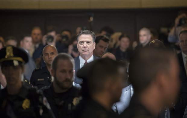Former FBI director James Comey walks through a corridor on the way to a secure room to continue his testimony to the Senate Select Committee on Intelligence, on Capitol Hill in Washington, Thursday, June 8, 2017. Comey, who was fired by President Donald Trump, told the panel in open session that Trump repeatedly pressed him for his