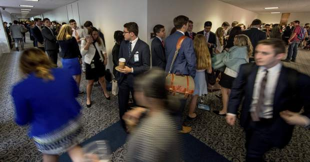 An enormous line stretches down the hall outside the room where Former FBI Director James Comey will testify before a Senate Intelligence Committee hearing on Capitol Hill, Thursday, June 8, 2017, in Washington. (AP Photo/Andrew Harnik)
