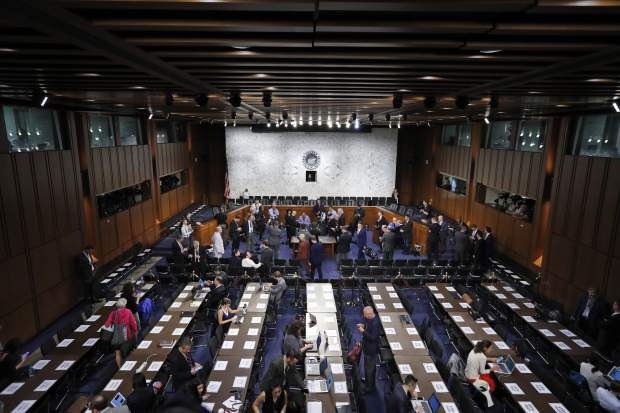 The hearing room is prepared for Former FBI Director James Comey to appear before the Senate Intelligence Committee, on Capitol Hill, Thursday, June 8, 2017, in Washington. (AP Photo/Alex Brandon)