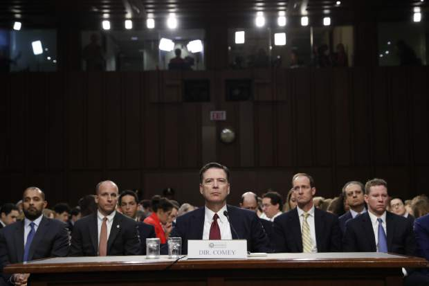 Former FBI director James Comey listens to the committee chairman at the beginning of the Senate Intelligence Committee hearing on Capitol Hill, Thursday, June 8, 2017, in Washington. (AP Photo/Alex Brandon)