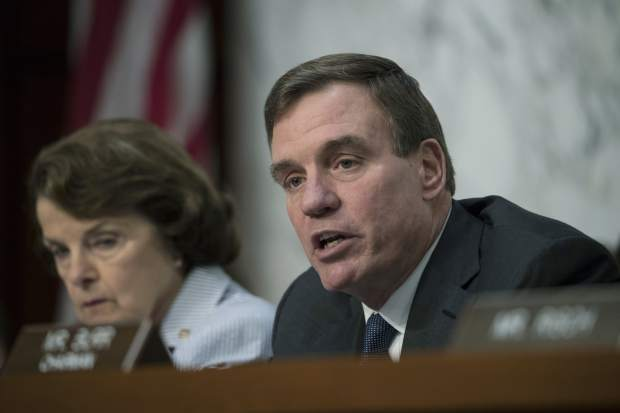 Senate Intelligence Committee Vice Chairman Mark Warner, D-Va., joined at left by Sen. Dianne Feinstein, D-Calif., gives his opening statement as former FBI director James Comey testifies on Capitol Hill in Washington, Thursday, June 8, 2017. (AP Photo/J. Scott Applewhite)