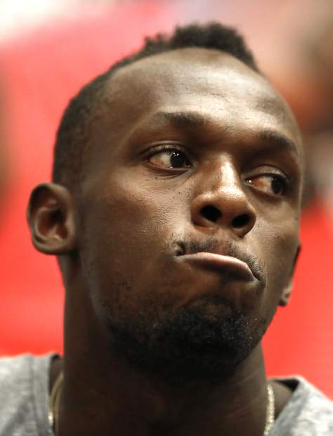 Jamaica's sprinter Usain Bolt grimaces during a press conference prior the Golden Spike Athletic meeting in Ostrava, Czech Republic, Monday, June 26, 2017. Bolt will compete in the 100 meters at the Golden Spike on Wednesday, June 28, 2017. (AP Photo/Petr David Josek)