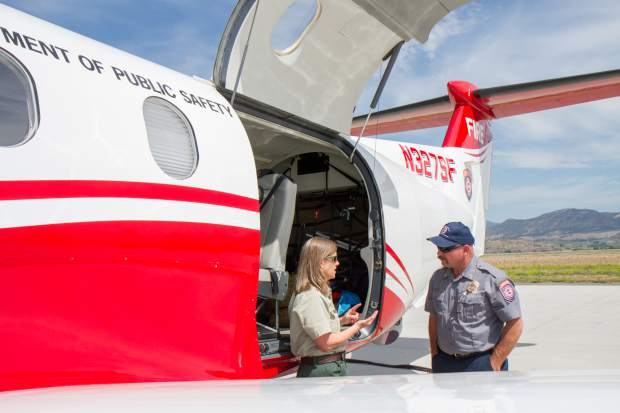 Forest Service employee Lisa Stoeffler and Vince Welbaum with the Colorado Division of Fire Prevention and Control talk during the 2017 media day at the Rifle Garfield County Airport.