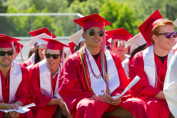 Glenwood Springs High School class of 2017 graduates look to friends and family during the commencement ceremony on Saturday at Stubler Memorial field.