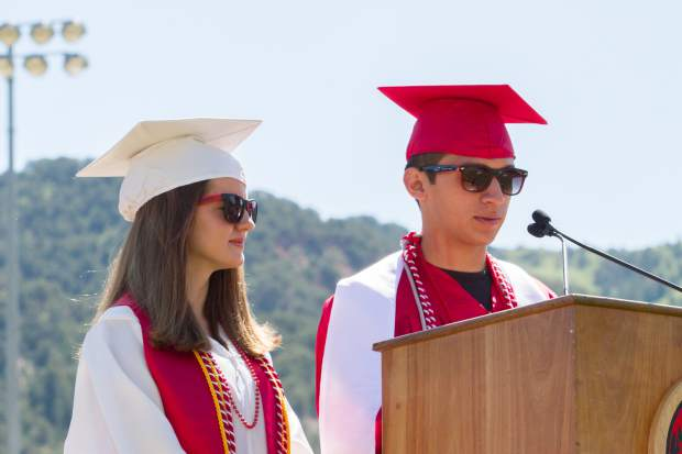 Jonathan Vazquez and  Kelly Fegan present to the school the class of 2017 senior gift.