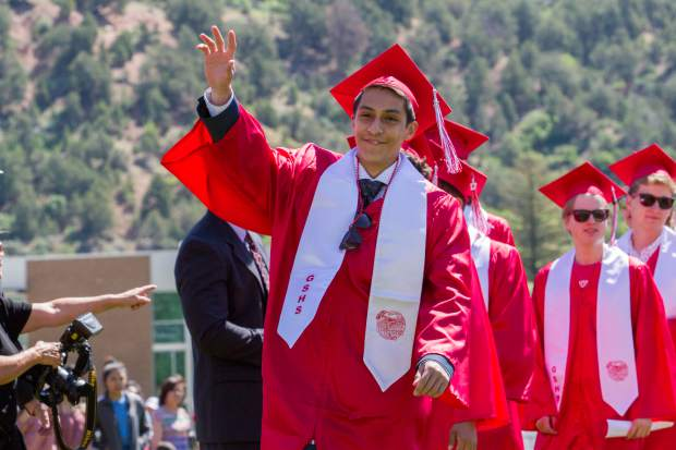 A member of the GSHS graduating class of 2017 points to his friends and family while walking to receive his diploma on Saturday morning at Stubler Memorial Field.