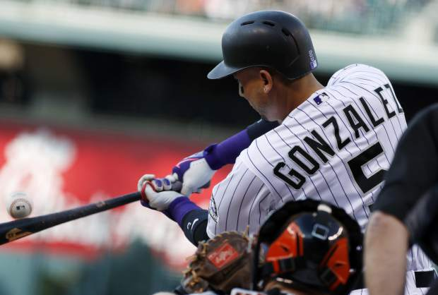 Colorado Rockies' Carlos Gonzalez connects for a soft line-out on a pitch from San Francisco Giants starter Jeff Samardzija in the first inning of a baseball game Friday, June 16, 2017, in Denver. (AP Photo/David Zalubowski)