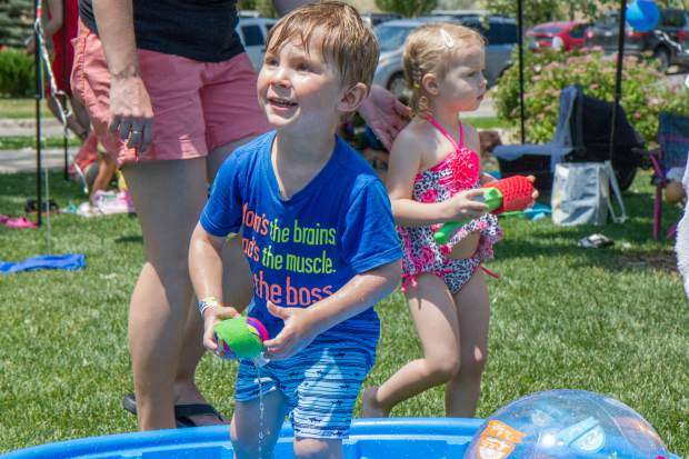 Puyton Hirons, 2, plays in the kiddie pool at the Glenwood Springs Community Center H2O Day.