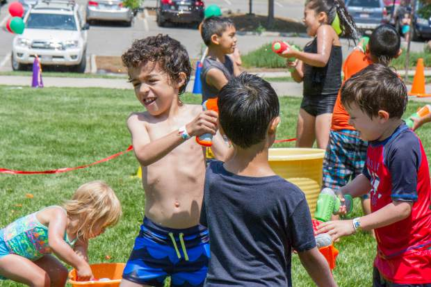 Kids spray each other with water guns at the Glenwood Springs Community Center H2O Day.