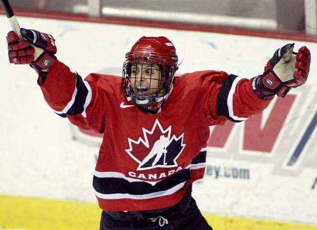 FILE - In this Nov. 10, 2004, file photo, Team Canada's Danielle Goyette celebrates after scoring the winning goal against Team Sweden during the final minutes of the third period of the Four Nations Tournament Lake Placid, N.Y. Goyette was selected to the Hockey Hall of Fame, Monday, June 26, 2017. (Paul Chiasson/The Canadian Press via AP, File)