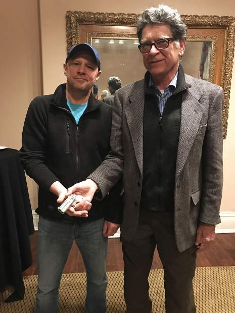 Jason Brierley of Vancouver, Canada, sold what he believes to be Doc Holliday's derringer to the Glenwood Springs Historical Society. At right is executive director Bill Kight.