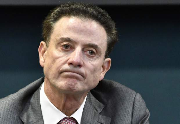 FILE - In this Oct. 20, 2016, file photo, Louisville coach Rick Pitino reacts to a question during an NCAA college basketball press conference in Louisville, Ky. The NCAA suspended Pitino, Thursday, June 15, 2017, for five ACC games following sex scandal investigation. A former men's basketball staffer is alleged to have hired strippers to entertain players and recruits. (AP Photo/Timothy D. Easley, File)