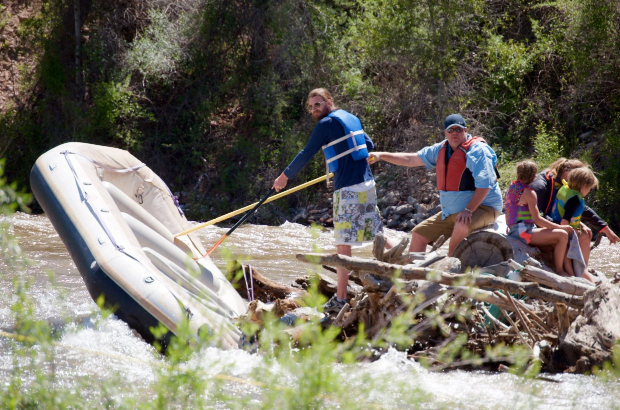 Protruding timber speared the front tube of this family's raft when the paddler misjudged the obstacle and struck it head-on.