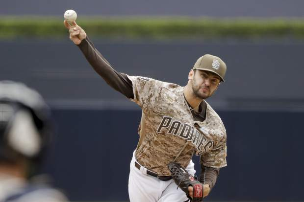 San Diego Padres starting pitcher Jarred Cosart throws to a Colorado Rockies batter during the first inning of a baseball game Sunday, June 4, 2017, in San Diego. (AP Photo/Gregory Bull)