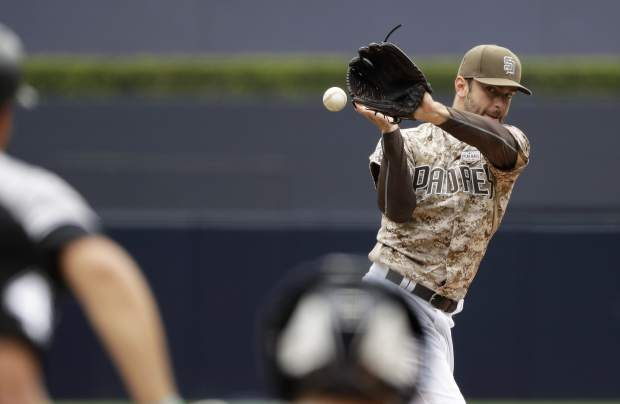 San Diego Padres starting pitcher Jarred Cosart cannot reach a single by Colorado Rockies' Nolan Arenado during the first inning of a baseball game Sunday, June 4, 2017, in San Diego. (AP Photo/Gregory Bull)