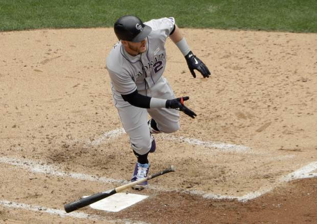 Colorado Rockies' Trevor Story watches his two-RBI single during the fourth inning of a baseball game against the San Diego Padres, Sunday, June 4, 2017, in San Diego. (AP Photo/Gregory Bull)