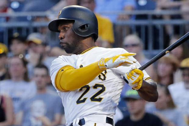 Pittsburgh Pirates' Andrew McCutchen drives in a run with a single off Colorado Rockies starting pitcher Kyle Freeland in the third inning of a baseball game in Pittsburgh, Monday, June 12, 2017. (AP Photo/Gene J. Puskar)