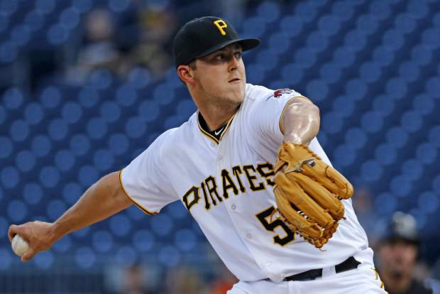Pittsburgh Pirates starting pitcher Jameson Taillon delivers in the first inning of a baseball game against the Colorado Rockies in Pittsburgh, Monday, June 12, 2017. (AP Photo/Gene J. Puskar)