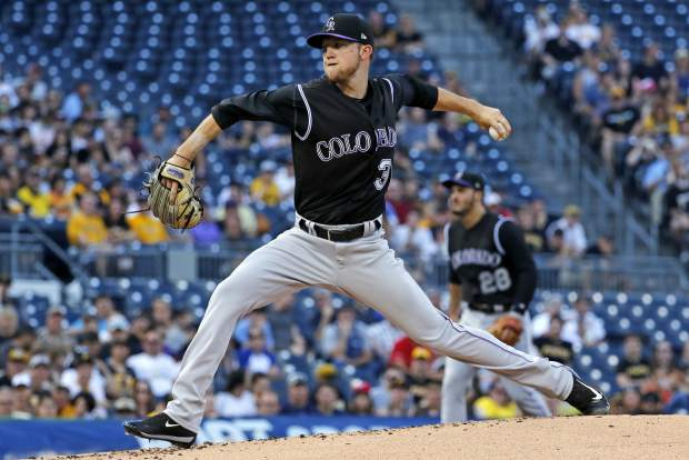 Colorado Rockies starting pitcher Kyle Freeland delivers in the first inning of a baseball game against the Pittsburgh Pirates in Pittsburgh, Monday, June 12, 2017. (AP Photo/Gene J. Puskar)