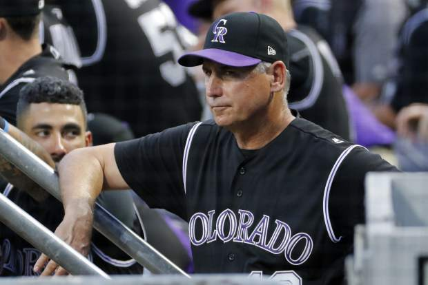 Colorado Rockies manager Bud Black, center, stands on the dugout steps during the fifth inning of a baseball game against the Pittsburgh Pirates in Pittsburgh, Monday, June 12, 2017. (AP Photo/Gene J. Puskar)