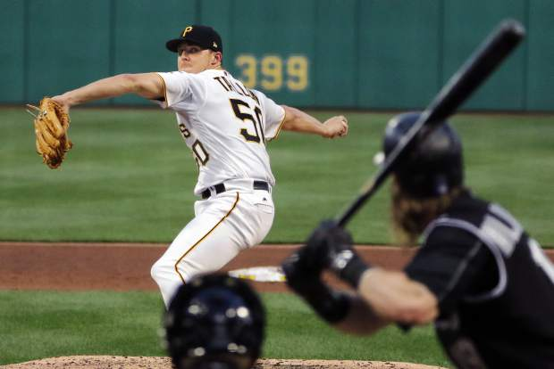 Pittsburgh Pirates starting pitcher Jameson Taillon delivers in the fifth inning of a baseball game against the Colorado Rockies in Pittsburgh, Monday, June 12, 2017. (AP Photo/Gene J. Puskar)